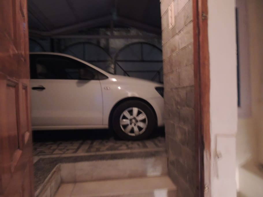 Entrance with a small parking. Though the parking can be organised for guests with cars