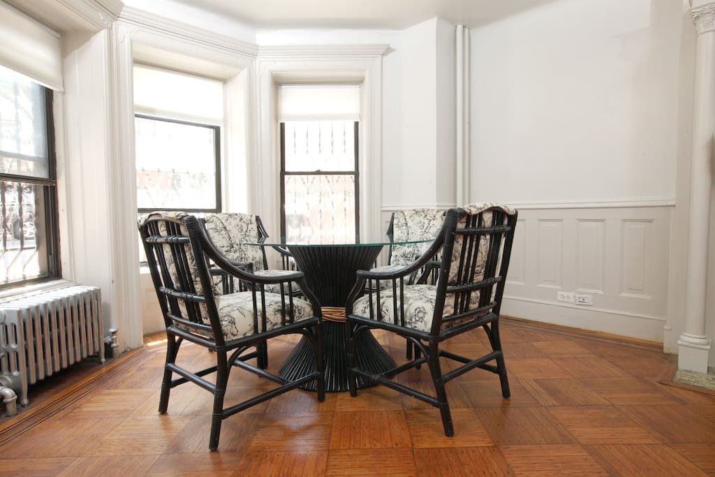 Dining table in the front bay window