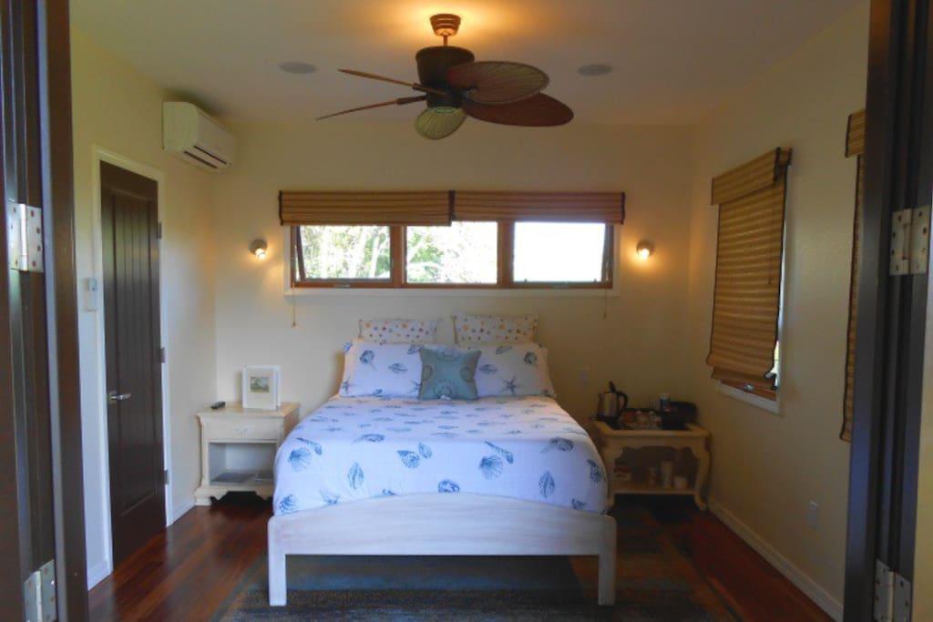Suite bedroom with sea motif.