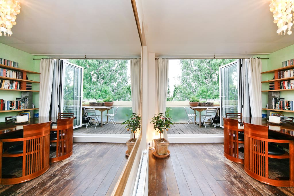 Clever mirror photo from the professional Airbnb photographer :).. The two dining chairs are Frank Lloyd Wright