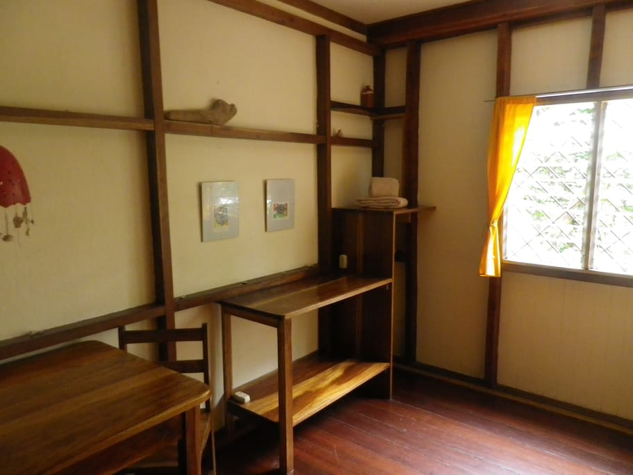 Room w double bed & shared bathroom