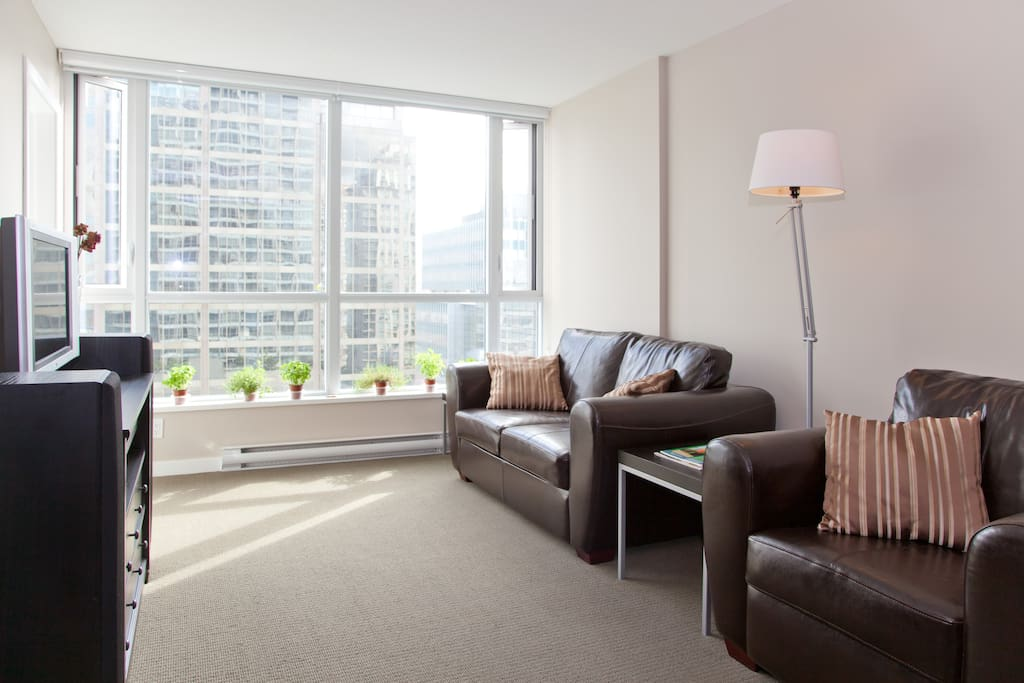 Airbnb Verified: The living room faces the north side looking over downtown Vancouver