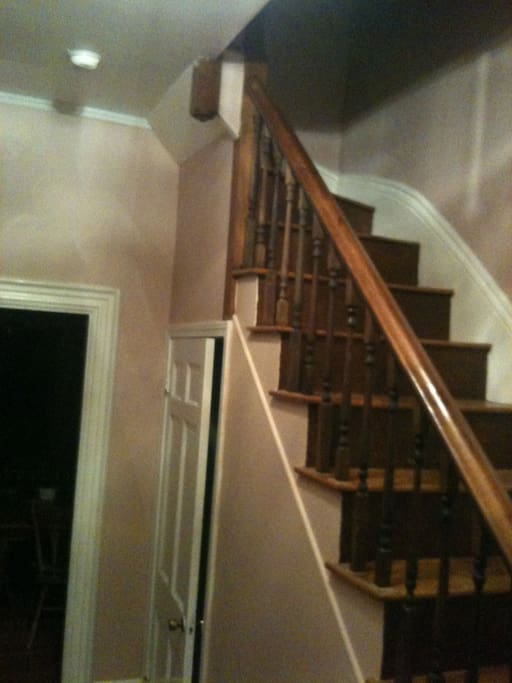 Staircase that leads to additional rooms.