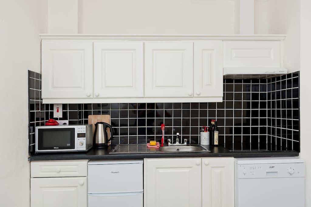 Microwave,dishwasher, tea coffee, breakfast, kettle,toaster, fridge etc