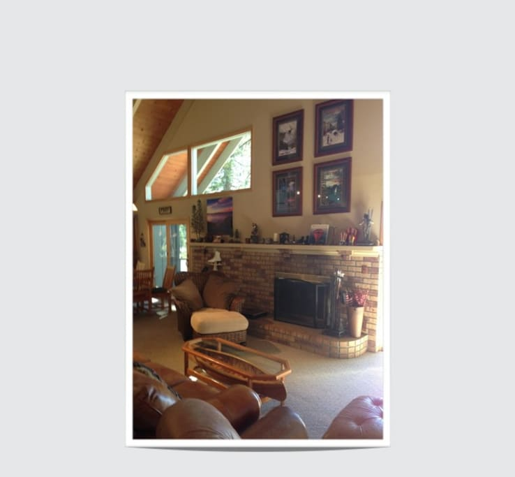 Large living room on second floor with wonderful Lake views and a wood burning fireplace