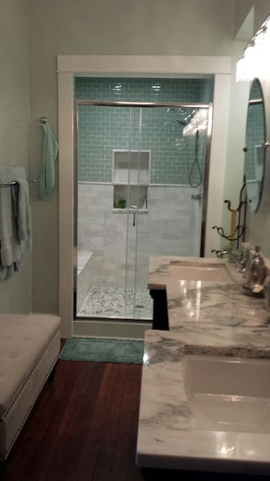Fully renovated master bath with marble and glass tile