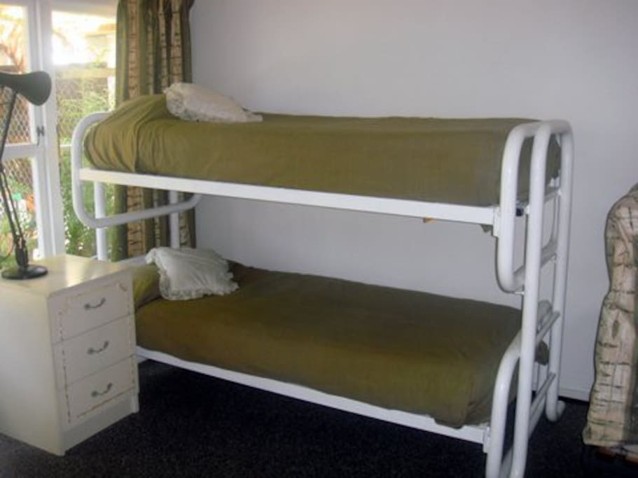 Third bedroom has bunks - The home is ideal for 6 people, but there is provision for three extras with the bed settee and folding beds