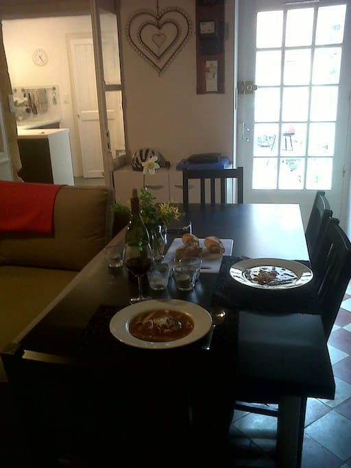 Dining table for indoor suppers. Seating for four to six.