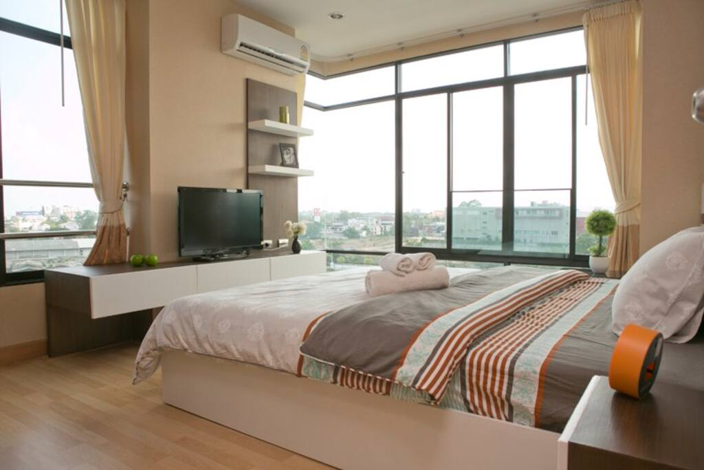 Enjoy the panoramic view of Chiang Mai from your bed. Or simply laze in bed and watch TV.