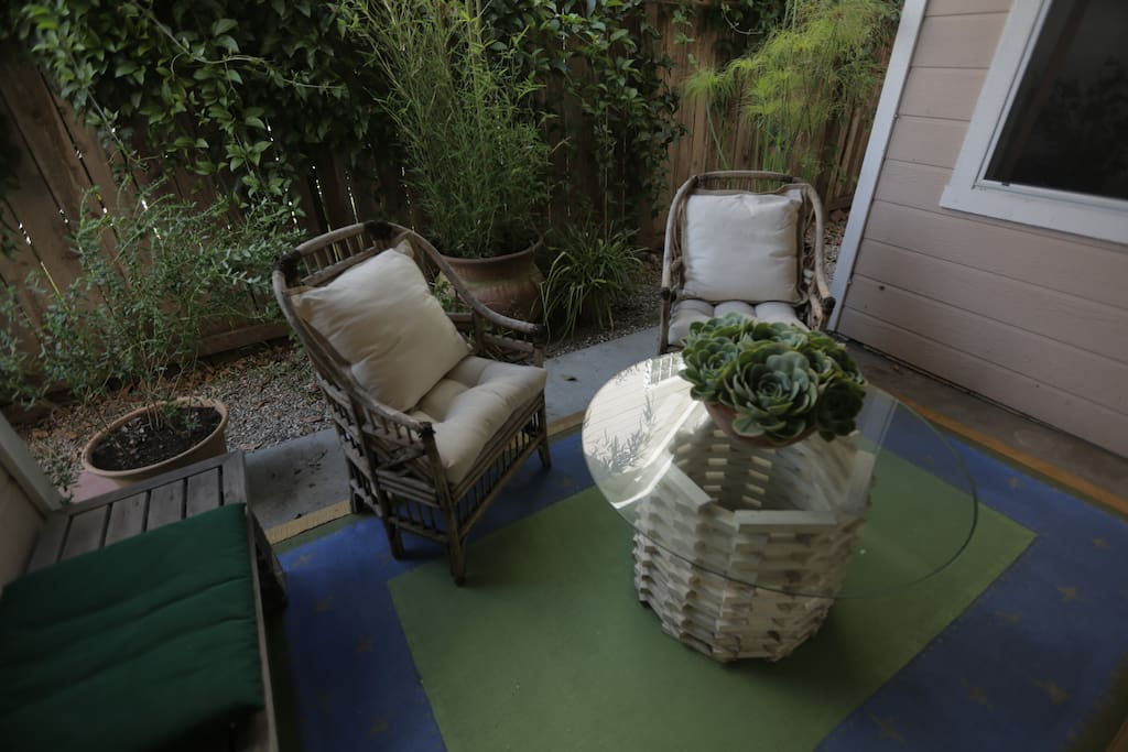 Outdoor zen patio seating for a warm evening.