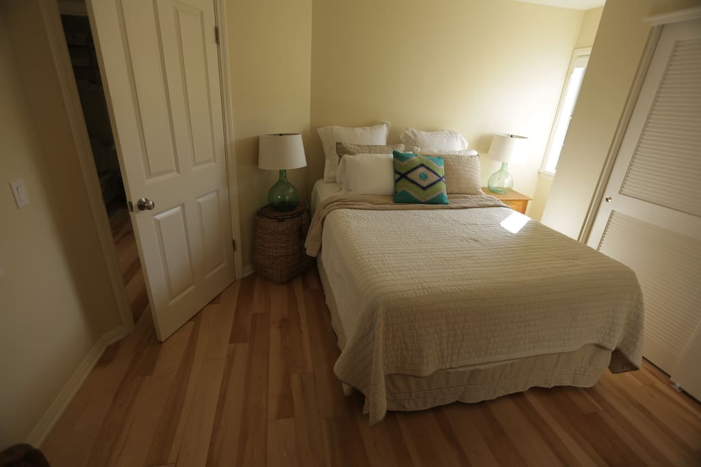 The Queen bedroom has a queen size bed with plush comfortable bedding.  It also has its own separate bathroom.