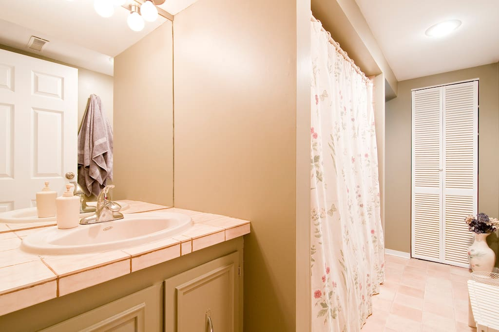 Private bathroom with full sized tub