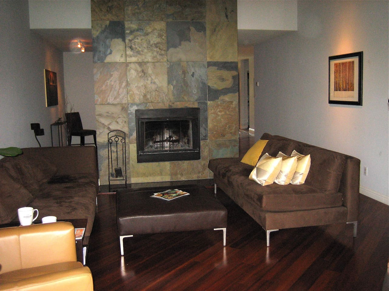 Living Room with 300 million year old slate / wood burning fireplace (wood included)