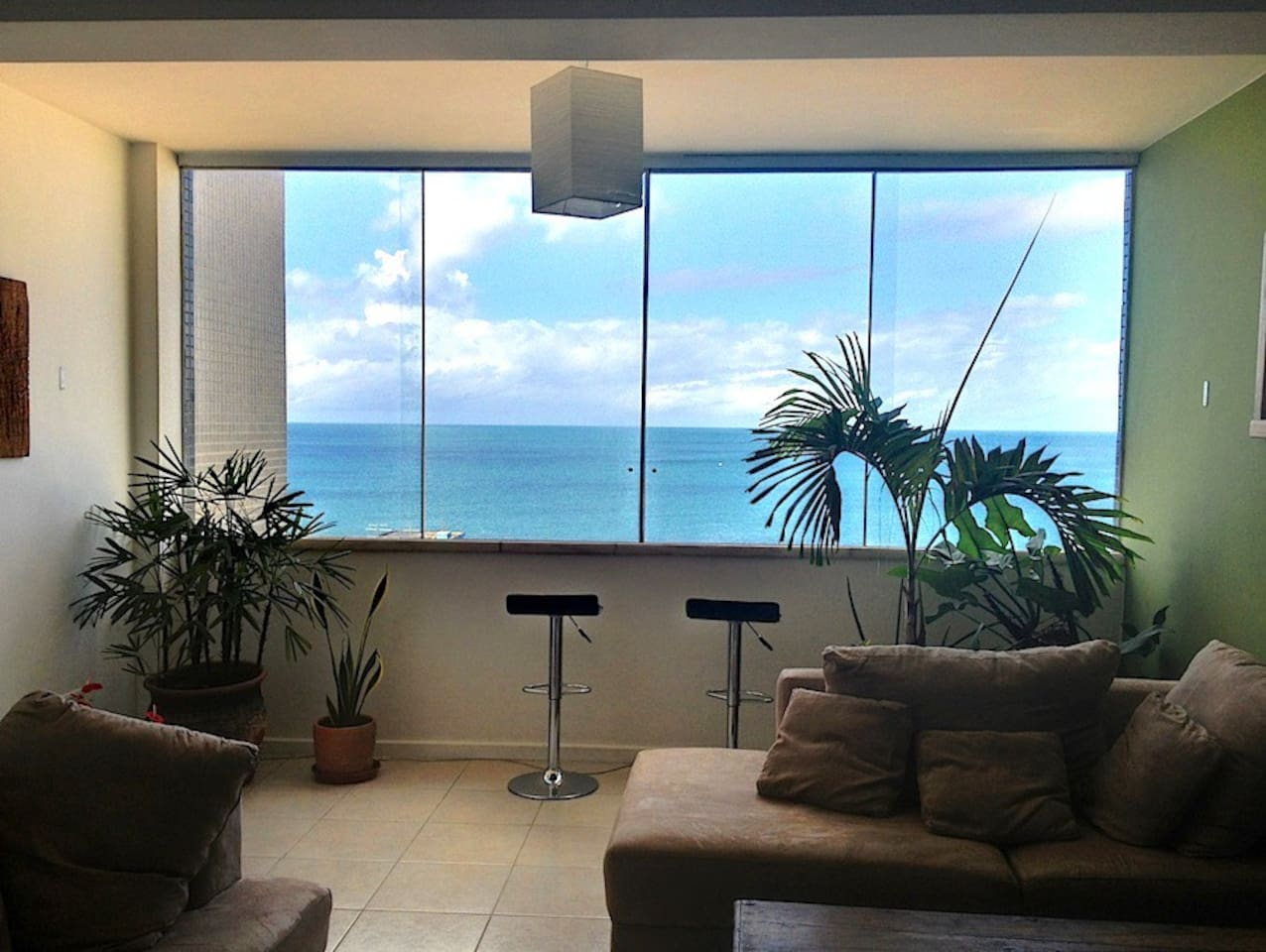 Bright living room with amazing ocean view. Sit and gaze out at the boats sailing past. June 2013.
