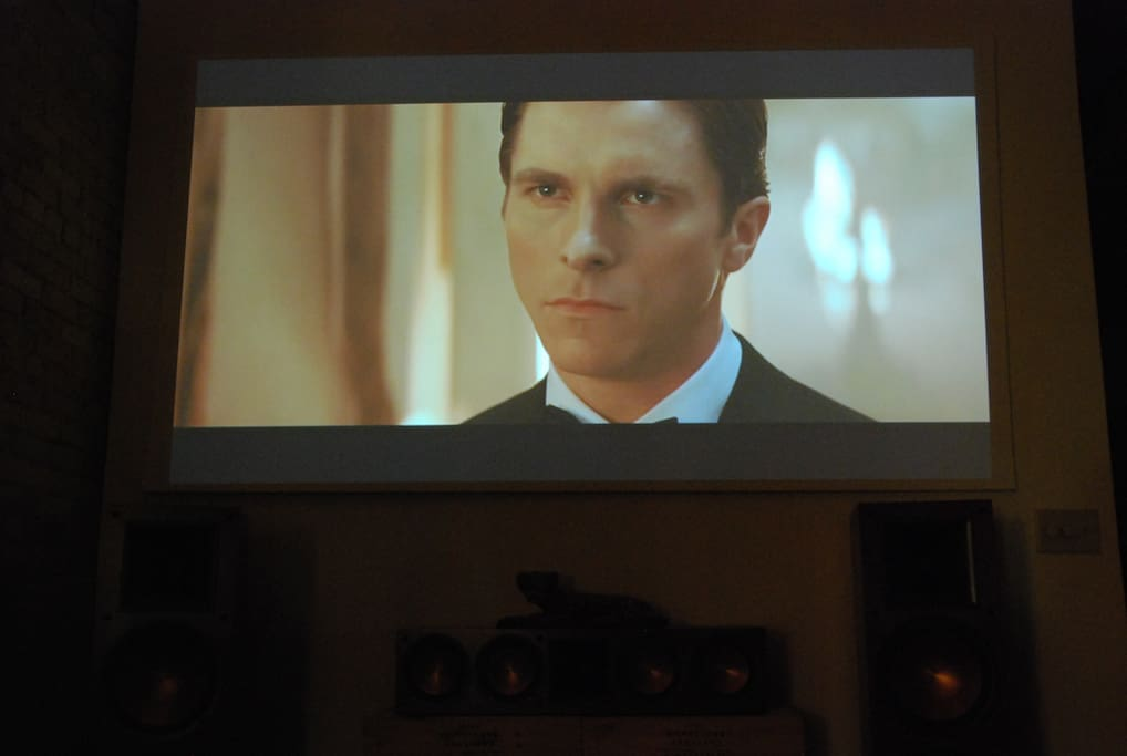 HD projector in action. Christian Bale lets you know he approves of the condo and is happy to have you.