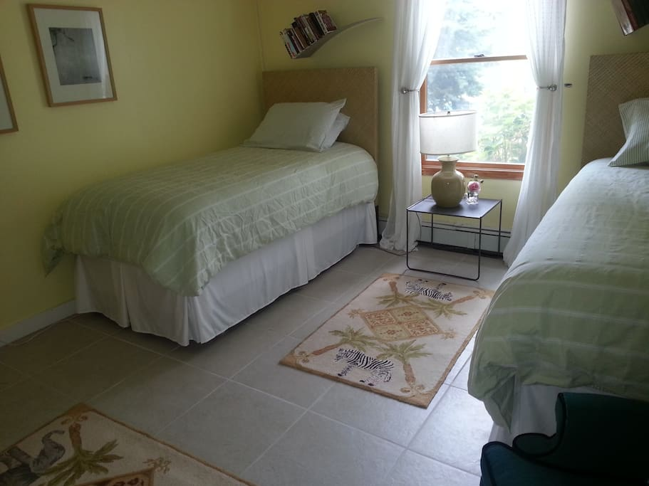 Two single beds in this bedroom, downstairs. (tiled floor)