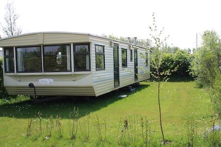 Sta caravan op gezellige kindvriendelijke camping. - Kisház