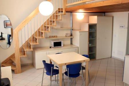 Monolocale spazioso e luminoso - Wohnung