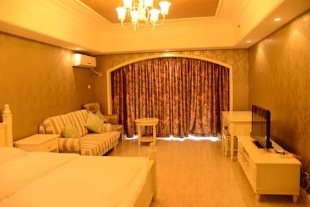 北戴河黄金海岸高尔夫球场私属海滩园景海景高端公寓1004 - Qinhuangdao