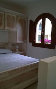 Residenza l'Orchidea - camera beige - Budoni - Bed & Breakfast