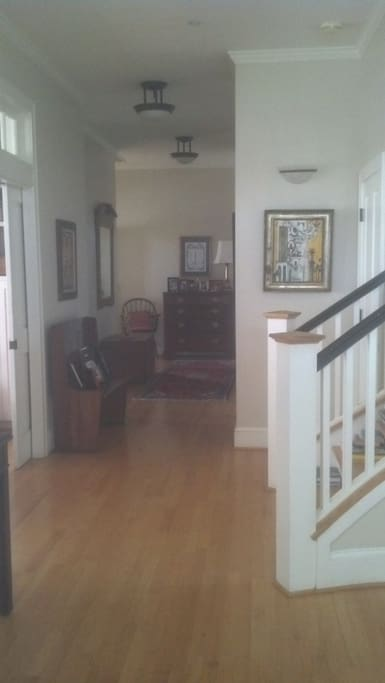 Stairs leading to bedroom immediately upon entering the house.