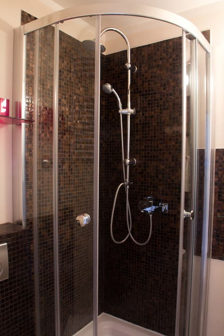 shower with gold brown mosaic stones