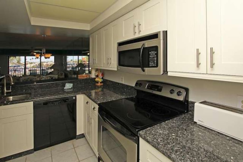 An updated kitchen with new appliances and granite counters,..