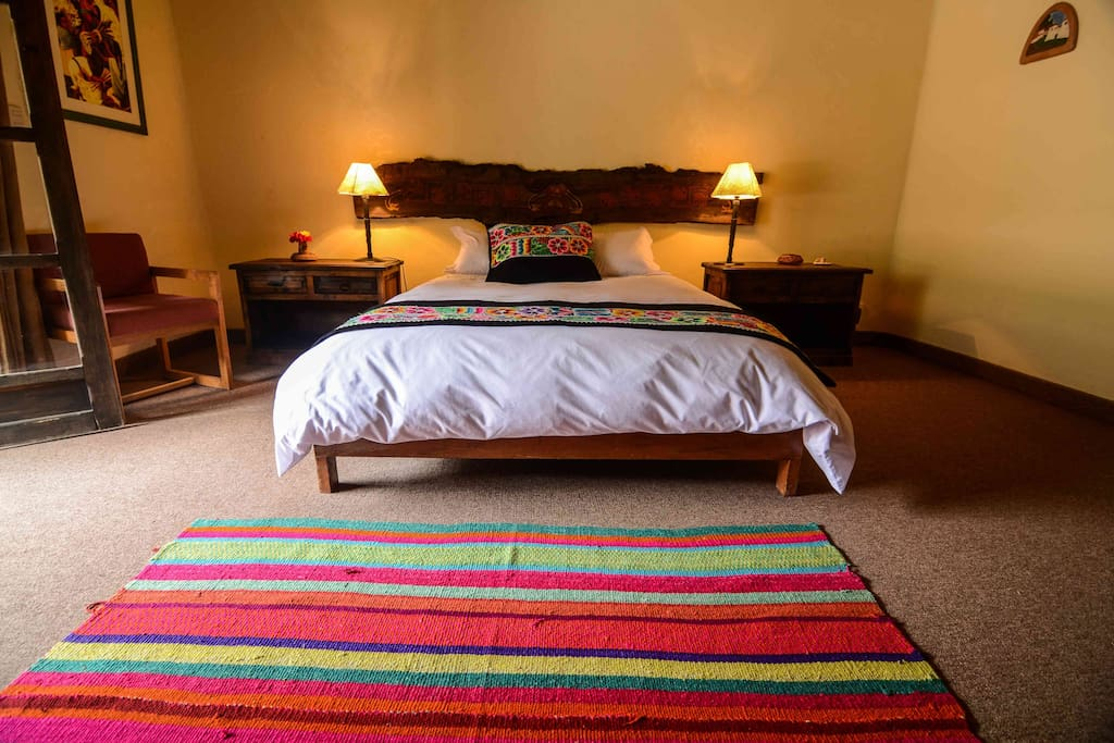 Our comfortable master bedroom with a woodfire place