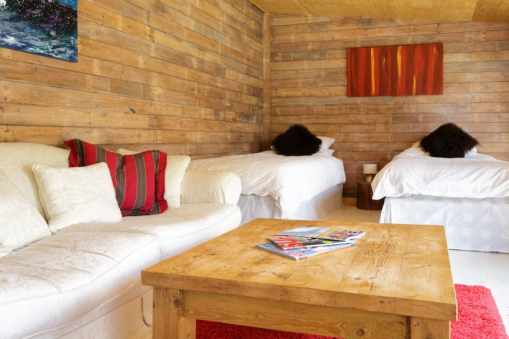 Cosy interior with comfy sofa and super kingsize bed (or twin beds)