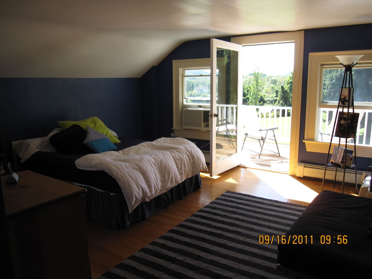 Large Room has queen size comfortable bed with porch/balcony overlooking field and pond