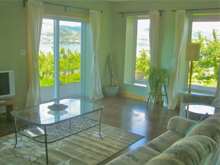 Living room with lovely view of organic orchard and lake.