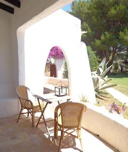 Rustic beach house in lush garden