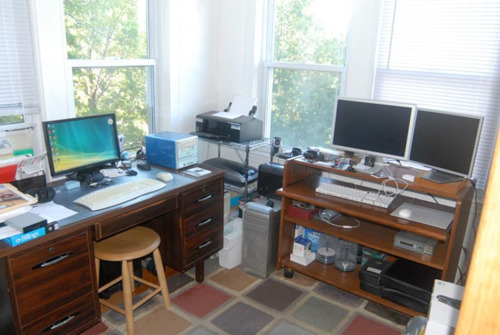 Modern office with printer, scanner, Macintosh, PC, and Linux computer systems.