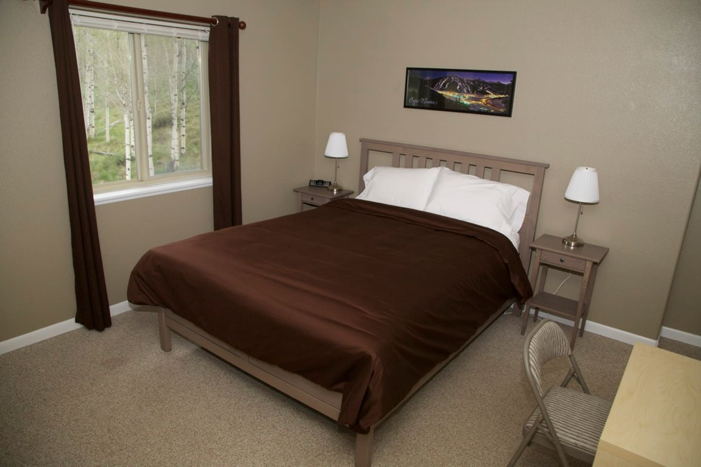 Look out on a beautiful aspen grove from the master bedroom