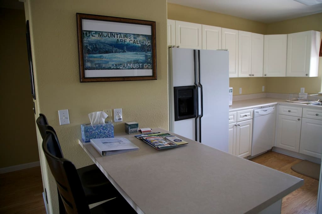 Fully stocked kitchen with coffeemaker, microwave, toaster and dishwasher