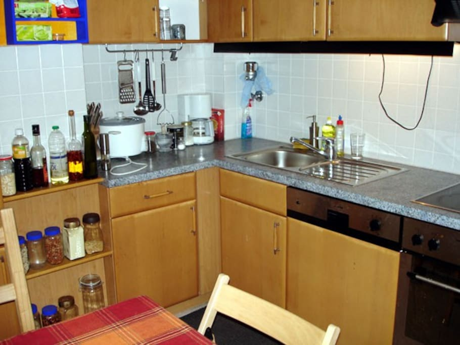 Complete kitchen with everything you need to cook including oven, microwave, dishwasher etc and another dining table.