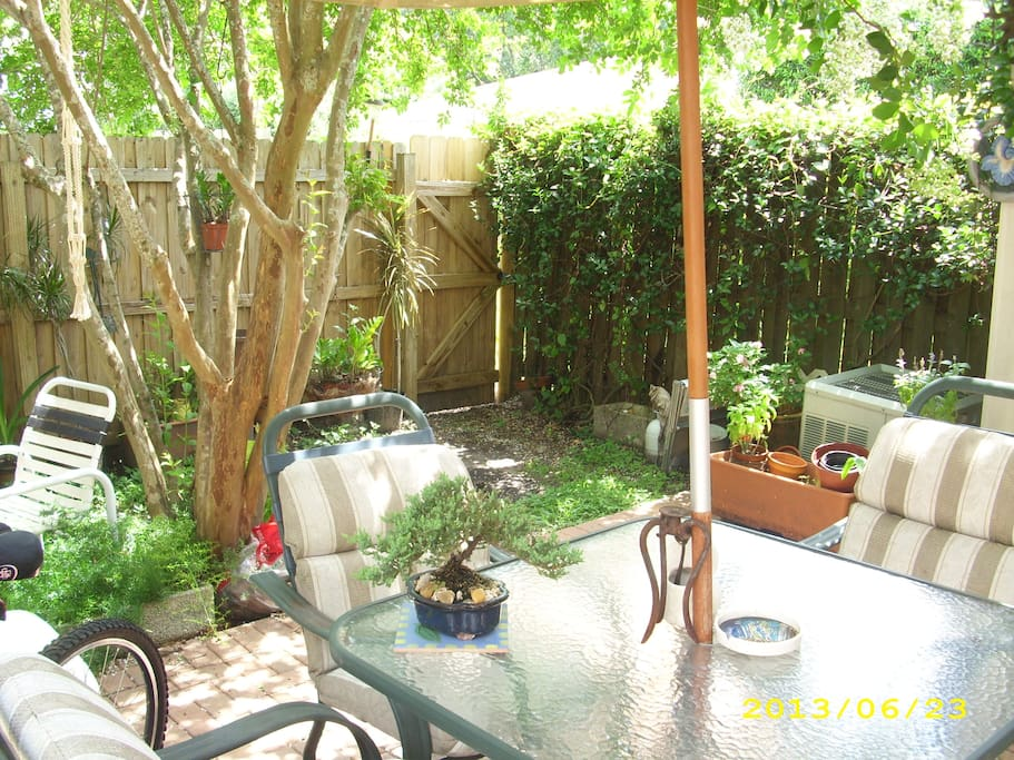 Garden patio where evening glass of wine is served...weather permitting!