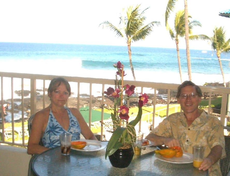 KonaDave and  April enjoying the condo lanai!  See how thrilled she is to be with him