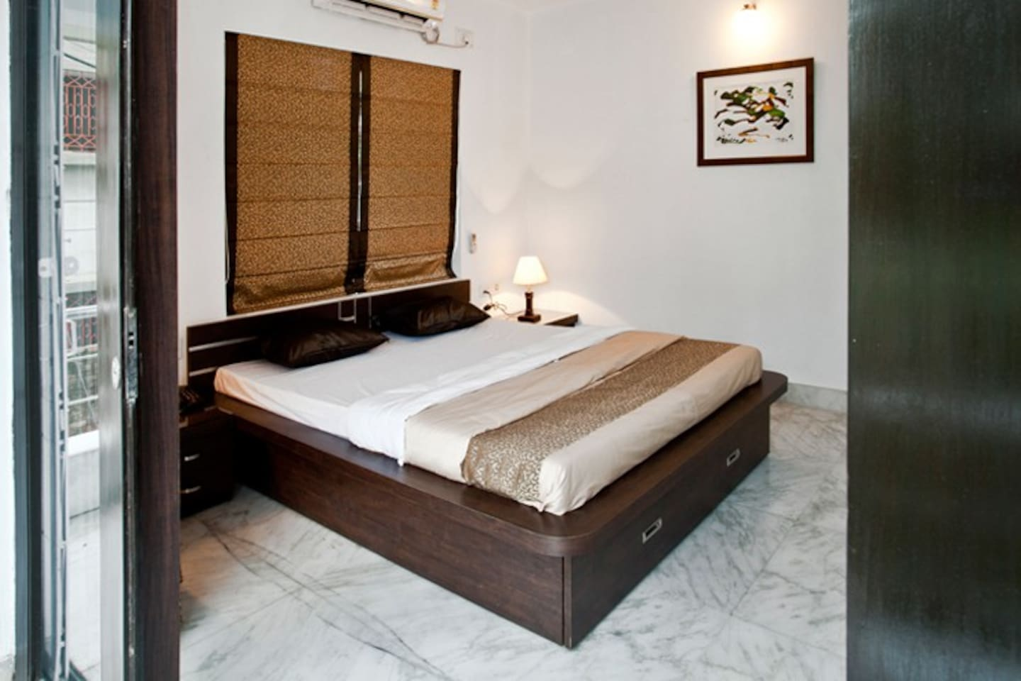 Bedroom with King Sized Bed, writing Desk,Wardrobe with Safe, attached Bath, and a Balcony!