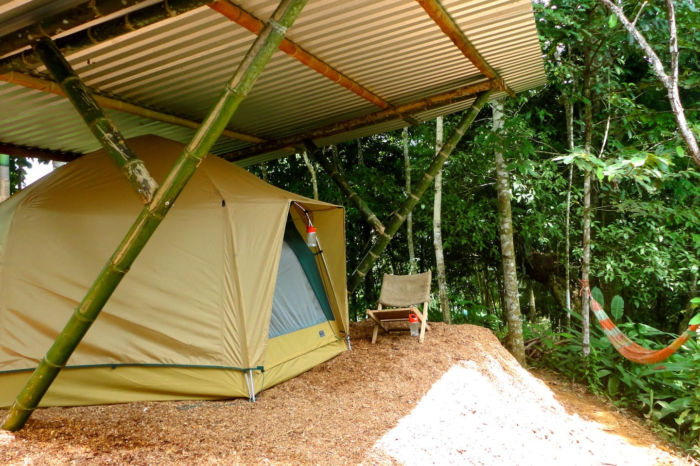 The Tent campsite comes with chairs, a relaxing hammock and a solar lantern.