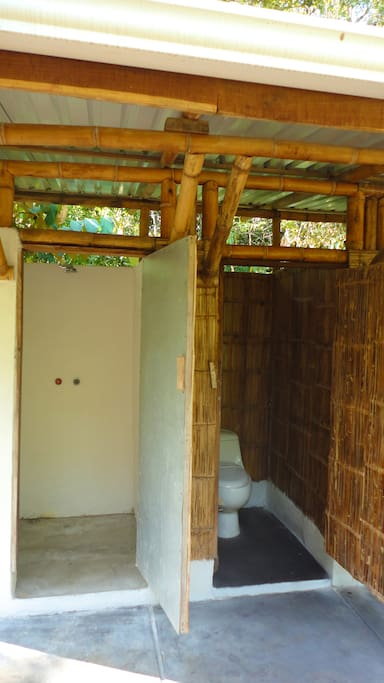The bathrooms use rainwater harvested from the farm and are made with locally sourced bamboo.