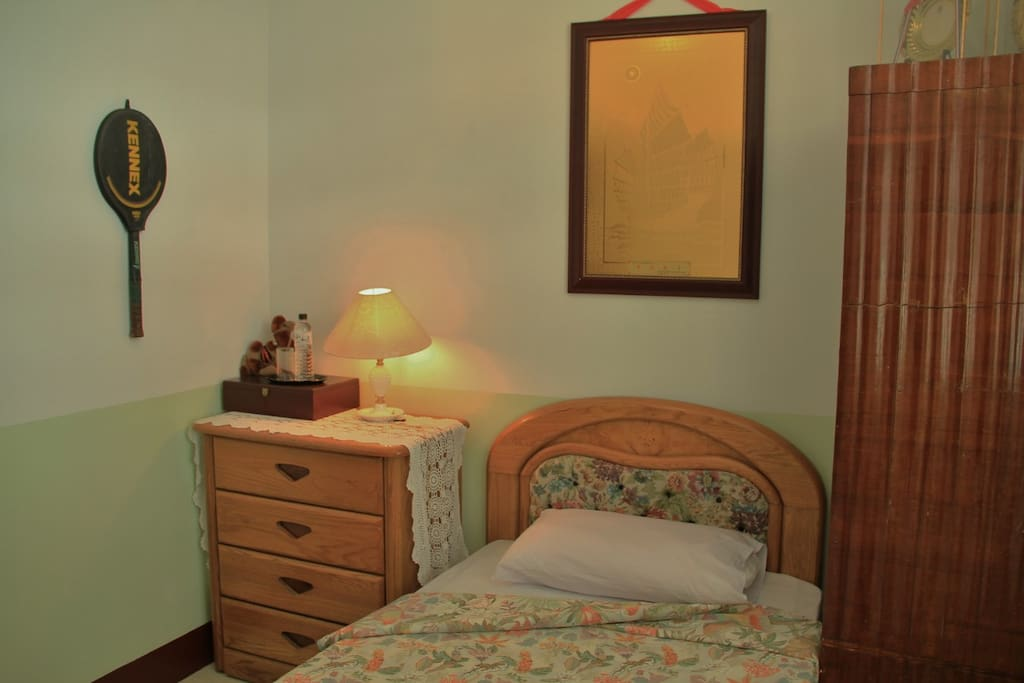 Single bed, chest of drawers, and wardrobe