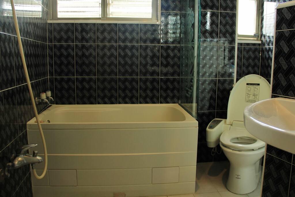 Bathroom with a bath and shower