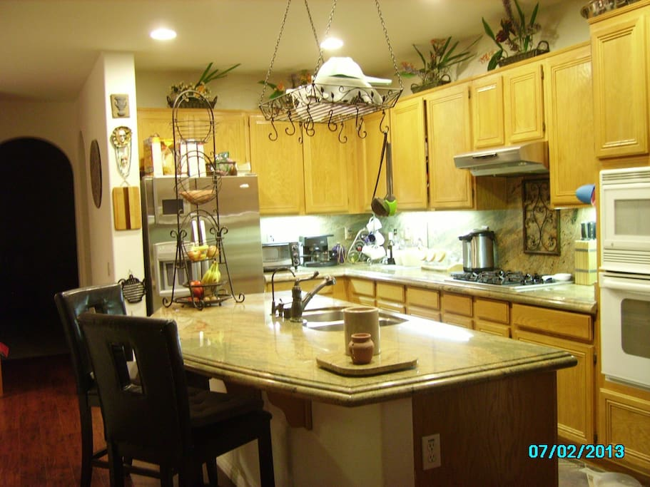 Our beautiful full kitchen with island and bar.