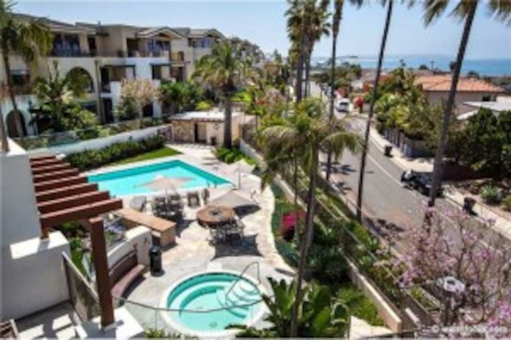 Pool area with Hot Tub, BBQ grills, Outdoor shower, restroom, and beach access