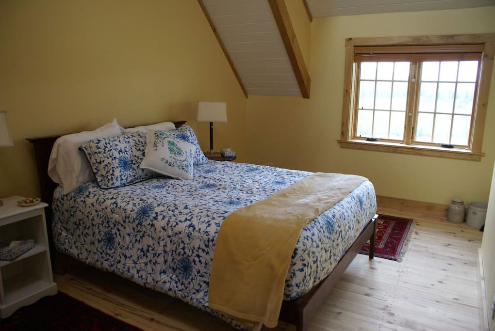 Queen Bedroom with fabulous views over the farm and surrounding countryside.