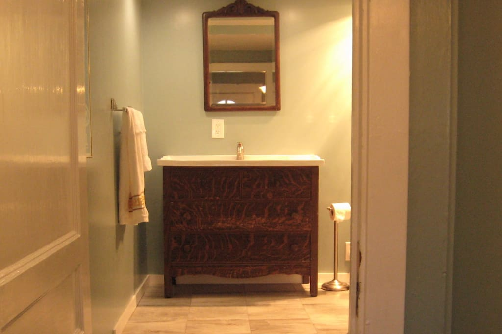 Entrance to newly renovated bathroom; ceramic tile floor