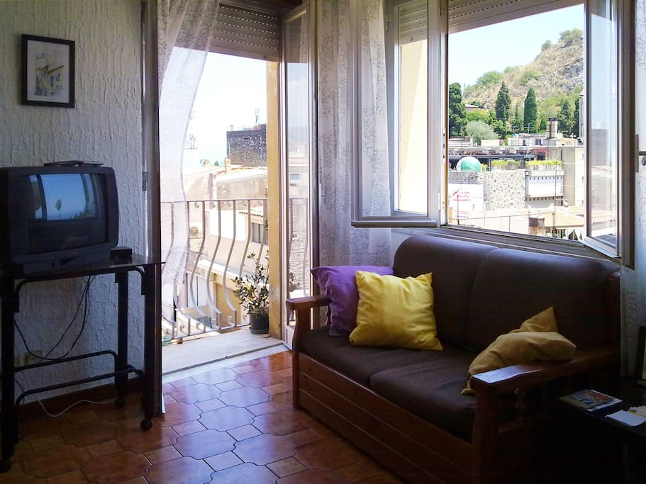 The living room:  a wonderful view over the historic center of Taormina.