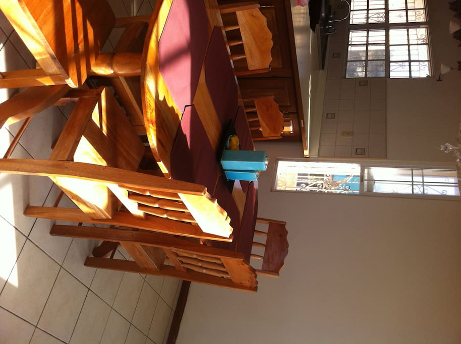 Dining Area, Locally Made Mahogany Table w/ Breakfast Bar w/view from Large Baywindows for natural light appreciation