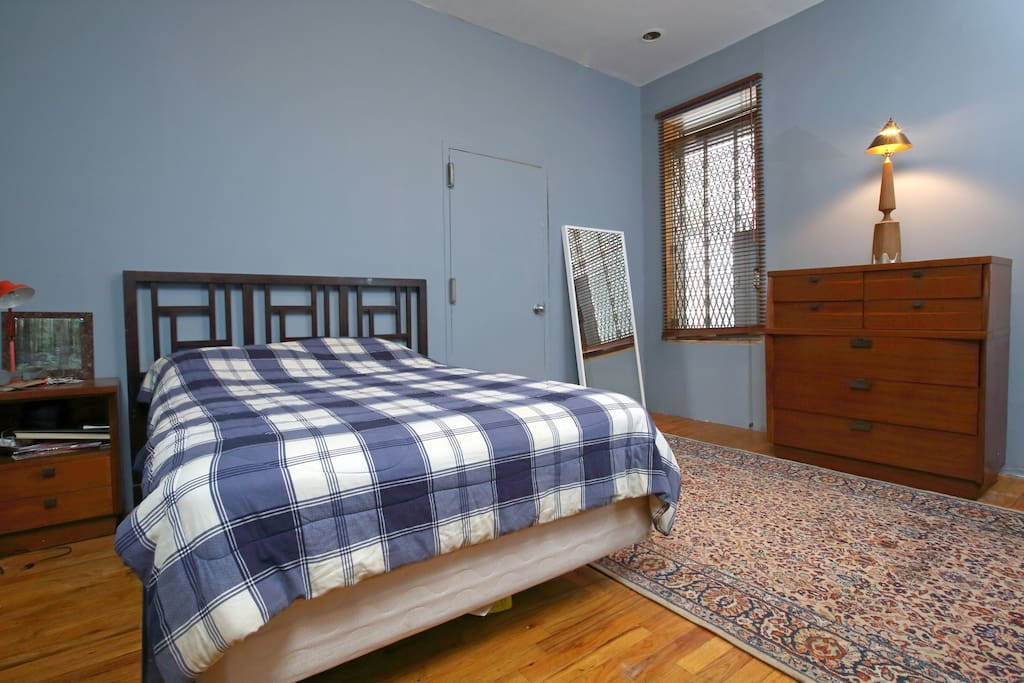 Bedroom, note private entrance door to building foyer next to bed